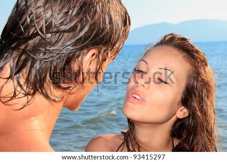 Young couple on a tropical beach - stock photo