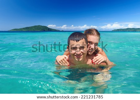 Young couple on beach holiday. - stock photo