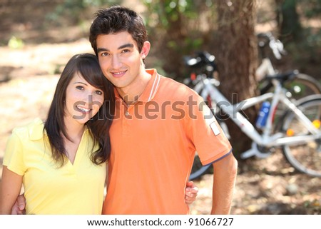 Young couple on bike ride - stock photo