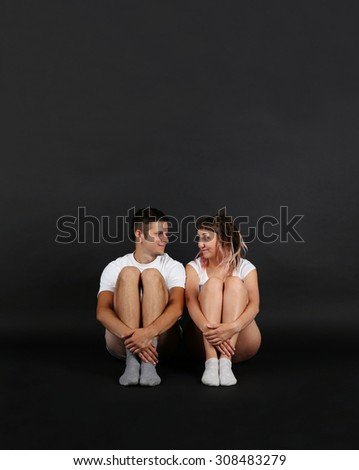 Young couple on black background