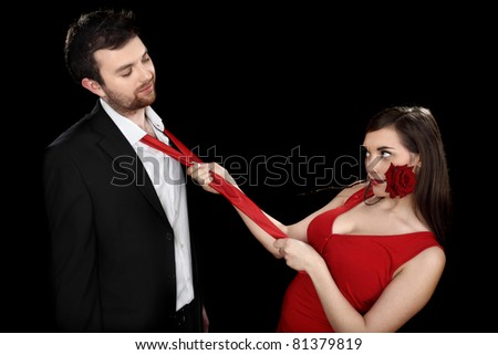 young couple on black background - stock photo