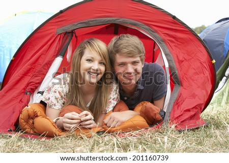 Young couple on camping trip - stock photo