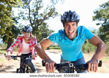 Young couple on country bike ride - stock photo