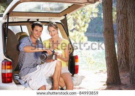 Young couple on country picnic - stock photo