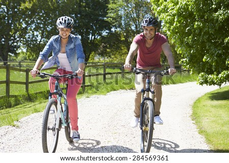 Young Couple On Cycle Ride In Countryside - stock photo