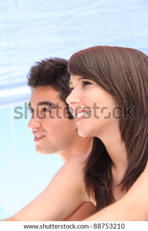 Young couple on holiday together - stock photo