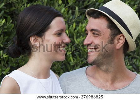 Young couple on holidays, casual, posing relax and looking each other - stock photo