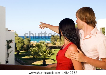 young couple on hotels terrace - stock photo