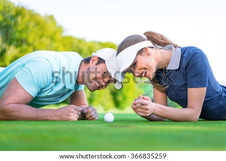 Young couple on the golf course - stock photo