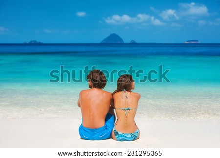 Young couple on the paradise beach - stock photo