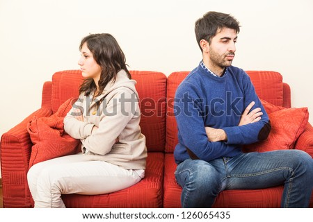 Young Couple on the Sofa after Quarrel - stock photo