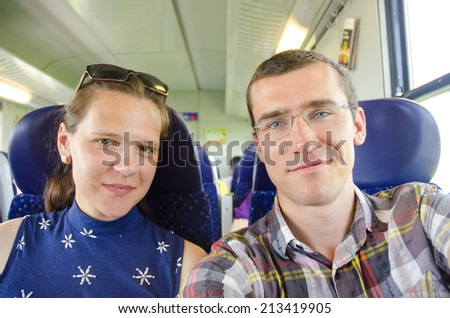 Young couple on vacation in Europe - on the train  - stock photo