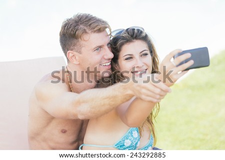 Young Couple on Vacation Taking Selfie - stock photo