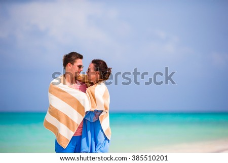 Young couple on white beach at summer vacation