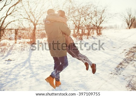 Young couple on winter road