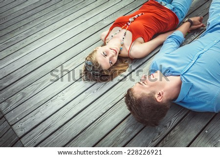 Young couple on wooden floor - stock photo