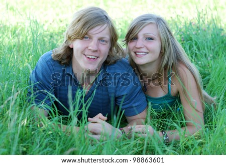 young couple outdoors in summer - stock photo