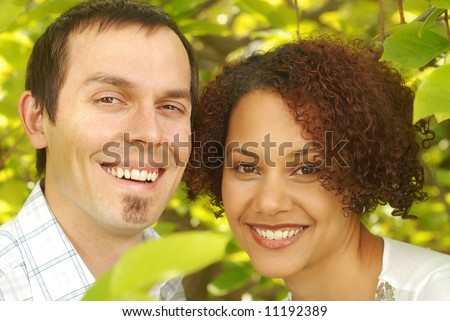 Young couple outside on a warm and bright sunny day - stock photo