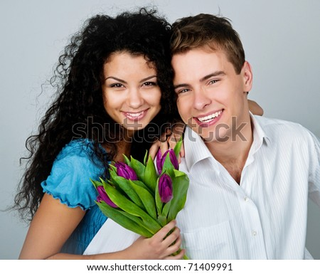 Young couple  over blue background - stock photo