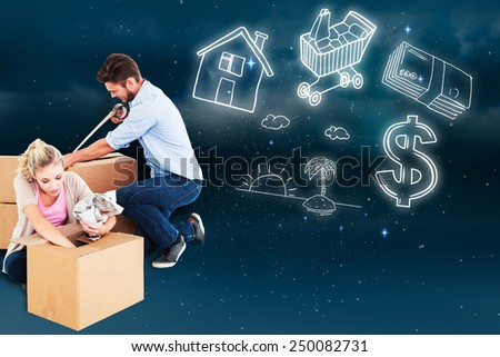 Young couple packing moving boxes against stars twinkling in night sky - stock photo