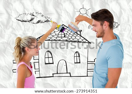 Young couple painting with brushes against crumpled white page - stock photo