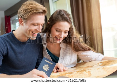 Young couple planning a trip together - stock photo
