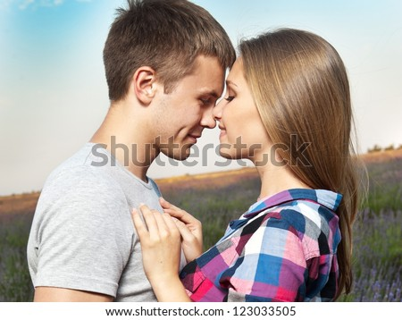 Young couple playing around in the lavender fields - stock photo