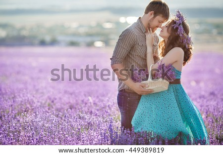 Young couple playing around in the lavender fields. Happy young couple having fun on lavender field. Romantic wedding couple in love. man and woman during summer holiday  - stock photo