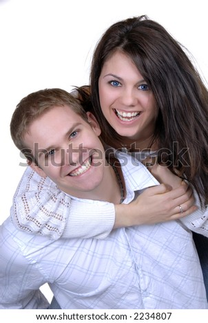 Young Couple Playing Around Riding Piggyback