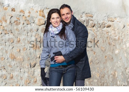 Young couple playing around the ruins - stock photo