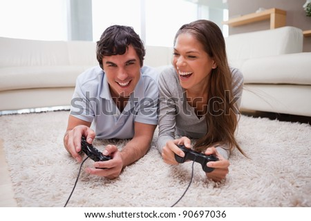 Young couple playing video games together - stock photo