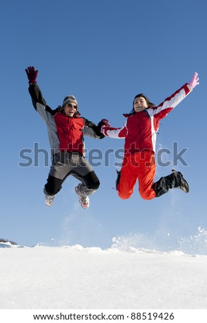 Young couple playing with snow outdoor in a sunny day - stock photo