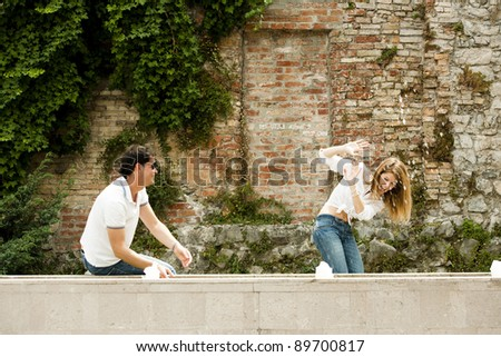 Young couple playing with water - stock photo