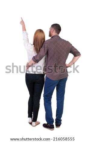 young couple pointing. Back view.  Rear view people collection.  backside view of person.  Isolated over white background. - stock photo