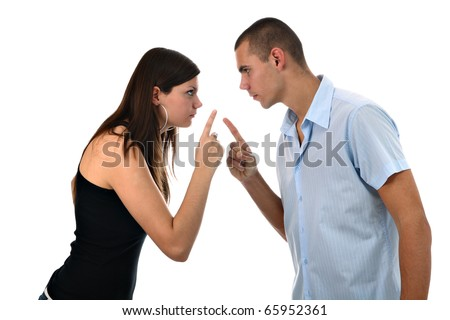 Young couple pointing fingers at each other isolated on white - stock photo