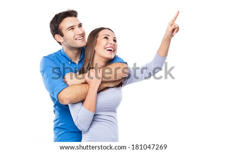 Young couple pointing up  - stock photo