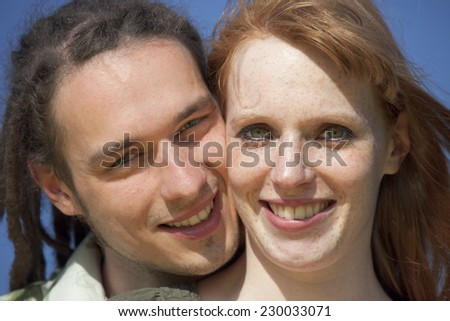 Young Couple Portrait against blue Sky - Germany, Europe - stock photo