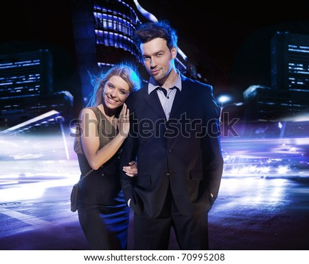 Young couple portrait in a city - stock photo