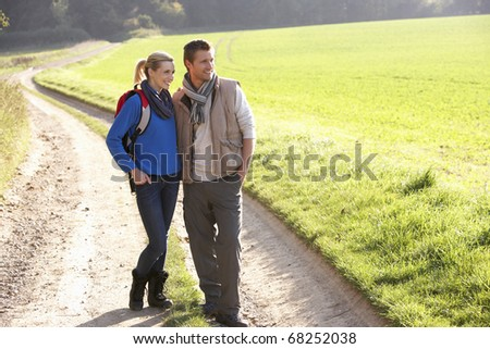 Young couple pose in park - stock photo