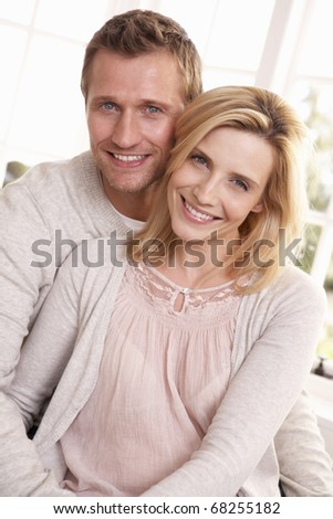 Young couple pose together - stock photo