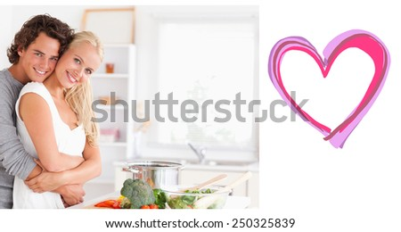 Young couple posing against heart - stock photo