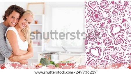 Young couple posing against valentines pattern - stock photo