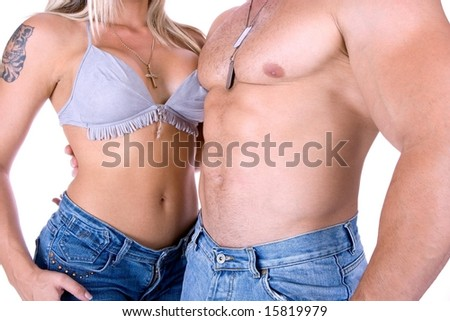 Young couple posing in jeans isolated on white - stock photo
