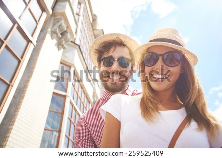 Young couple posing in sunglasses - stock photo
