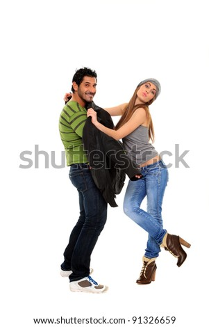 young couple posing on a studio isolated on a white background