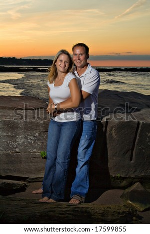Young couple posing on beach at sunset - Location, Cleveland, Ohio