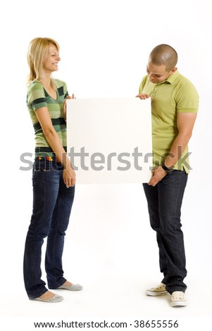 young couple presenting a blank board over white background - stock photo