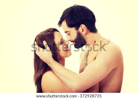 Young couple pretending to kiss each other. - stock photo