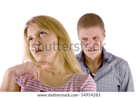 Young couple quarrel. A man in a rage, the woman is indifferent. - stock photo