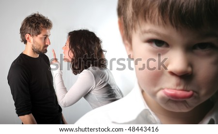 Young couple quarreling and closeup to a sad child - stock photo